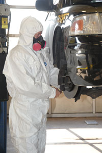 Motor Vehicle Division mechanic performing brake inspection on vehicle