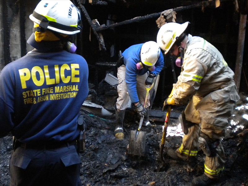 Fire Investigators digging at the scene of a fire