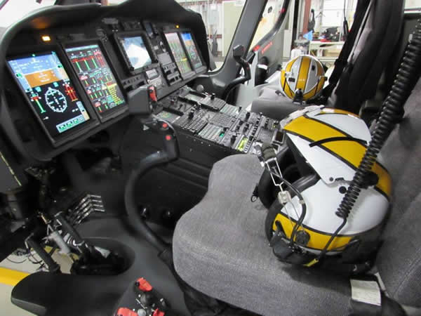 Cockpit of a helicopter with helmets on the seats